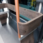 a-closer-look-at-the-wooden-handrails-aluminum-poles-and-linoleum-floors
