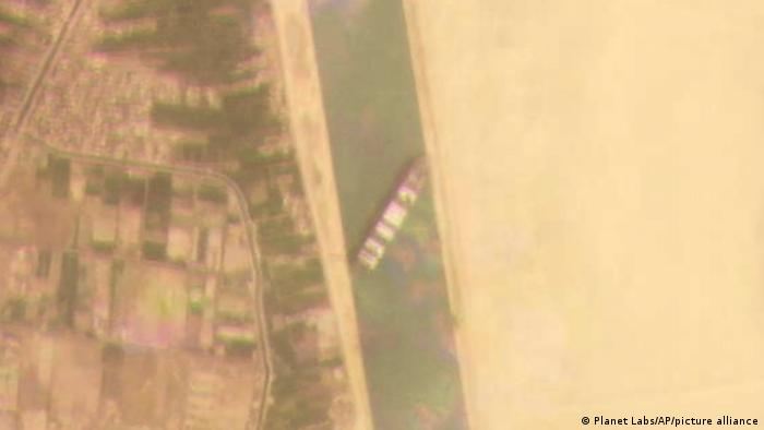 This satellite image shows the cargo ship MV Ever Given stuck in the Suez Canal